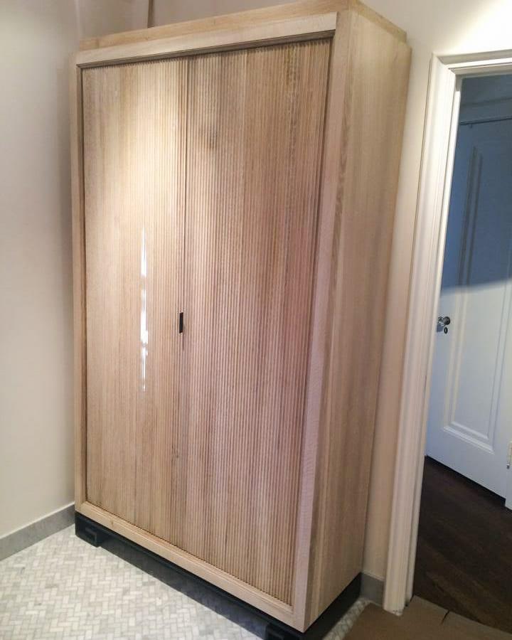 fluted white oak bathroom linen cabinet