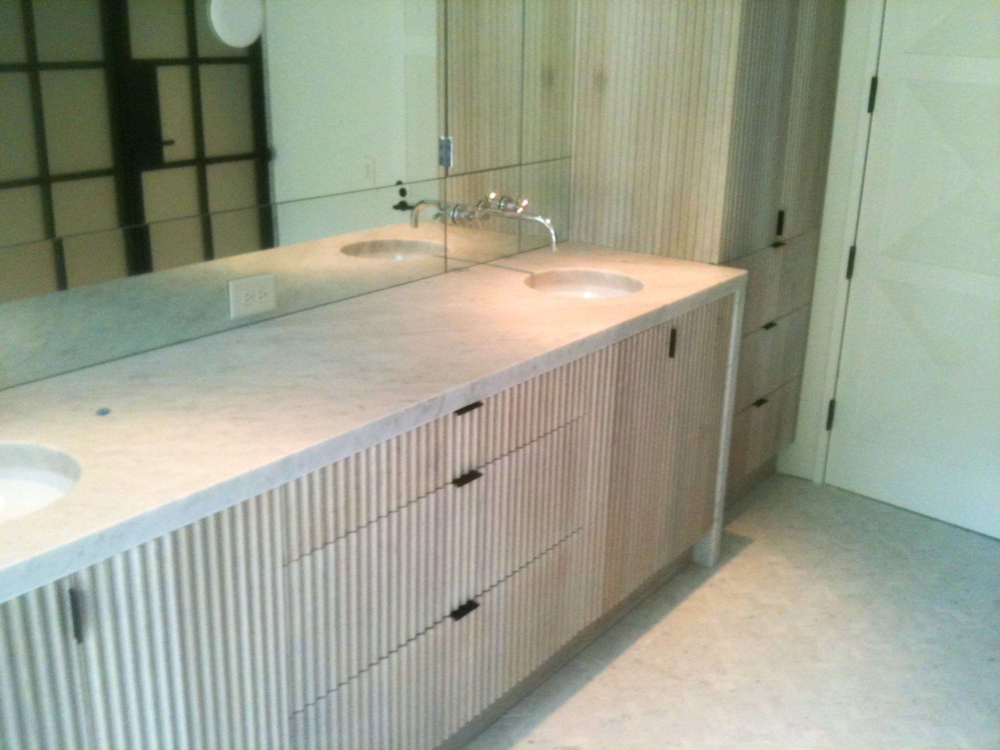 Fluted Light Wooden Vanity with marble countertop