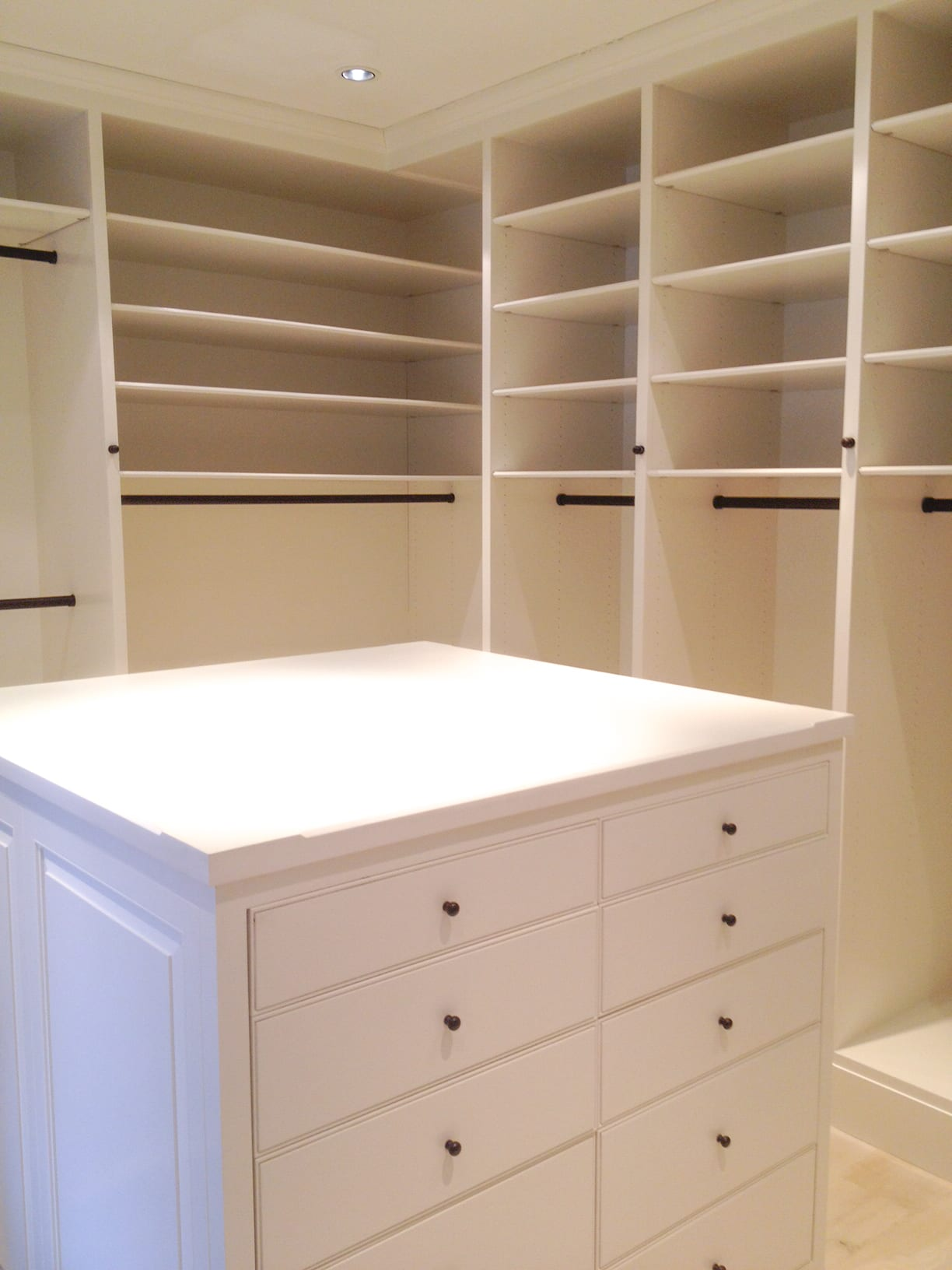 White Wooden Walk in Closet with built in shelves