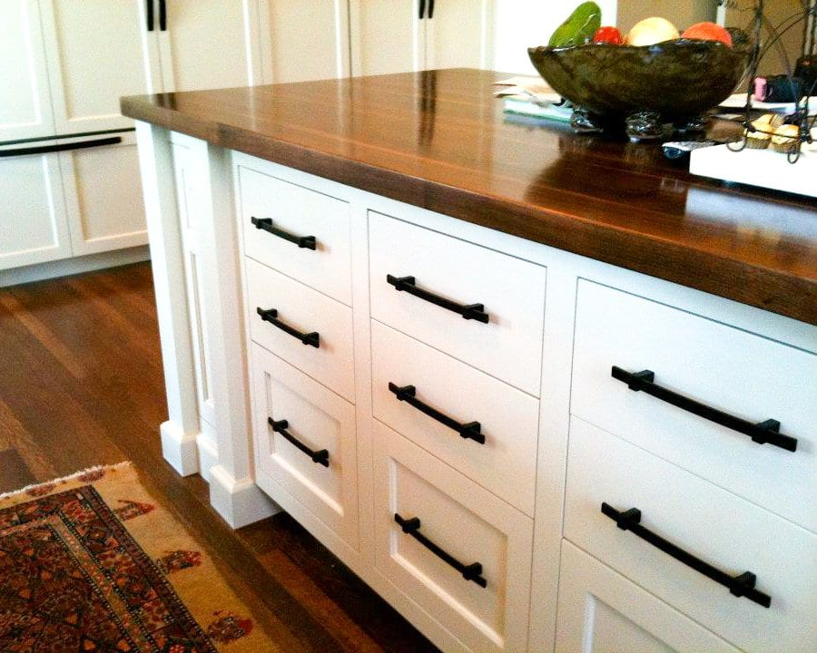 White Cabinetry with Walnut countertops