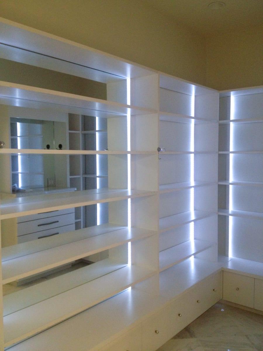 Sleek White Closet with Wall to Wall Shelves