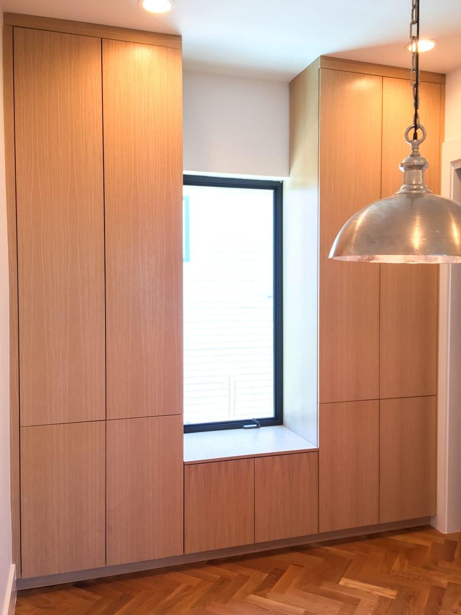 Sleek Floor to ceiling wood cabinetry
