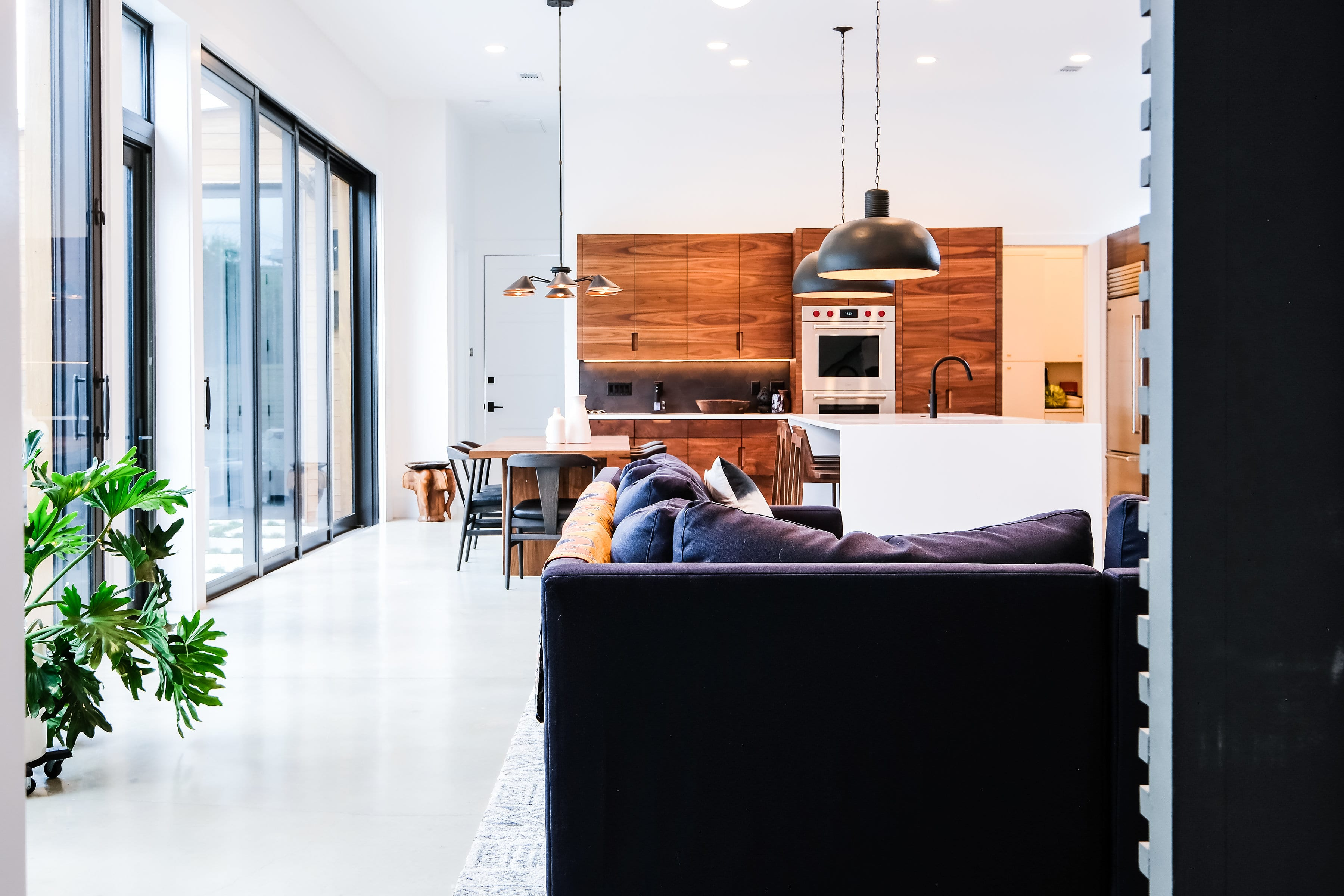 Black, White, and Walnut Kitchen from living room view