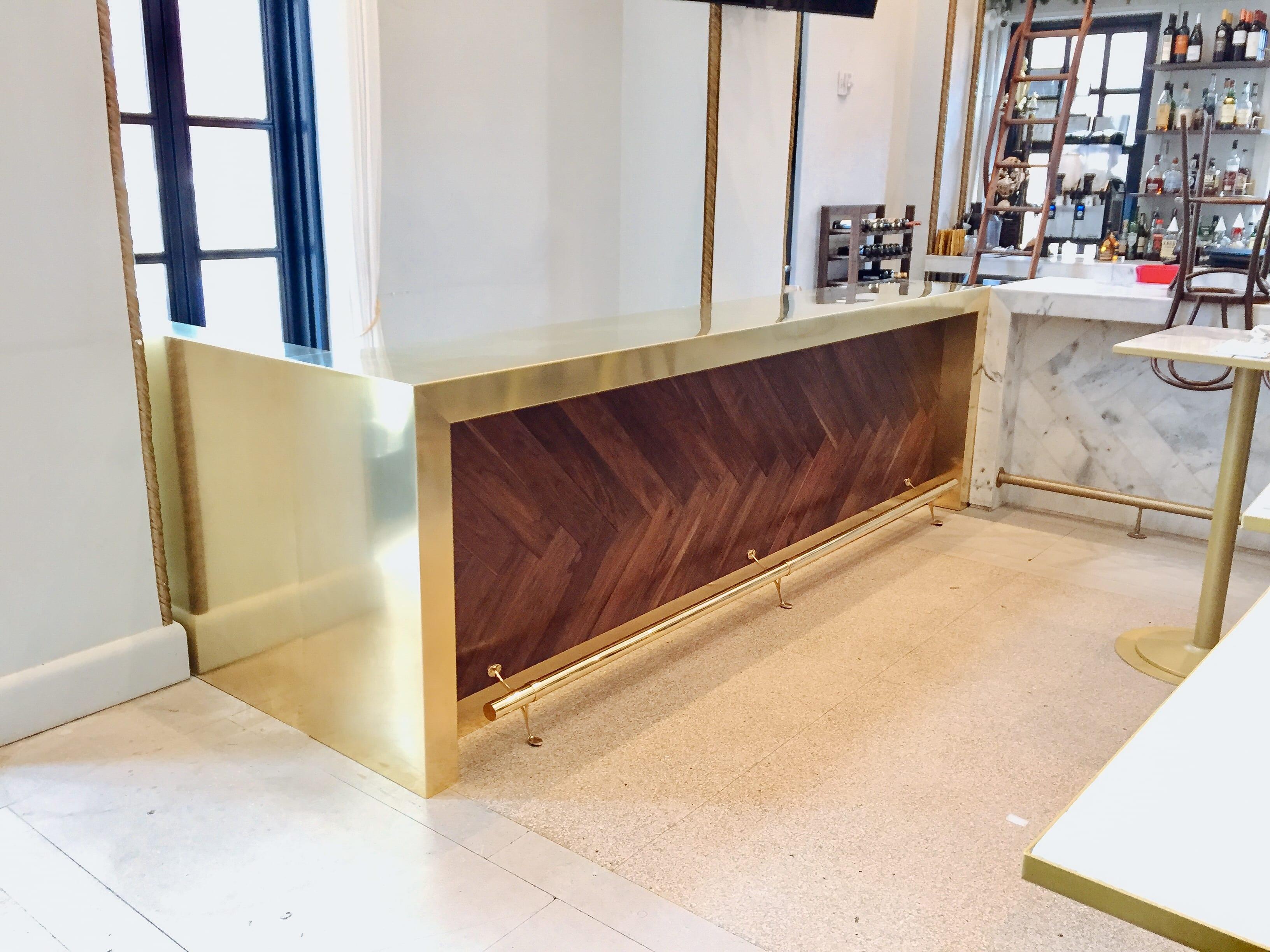 Brass Counter with Walnut herringbone details