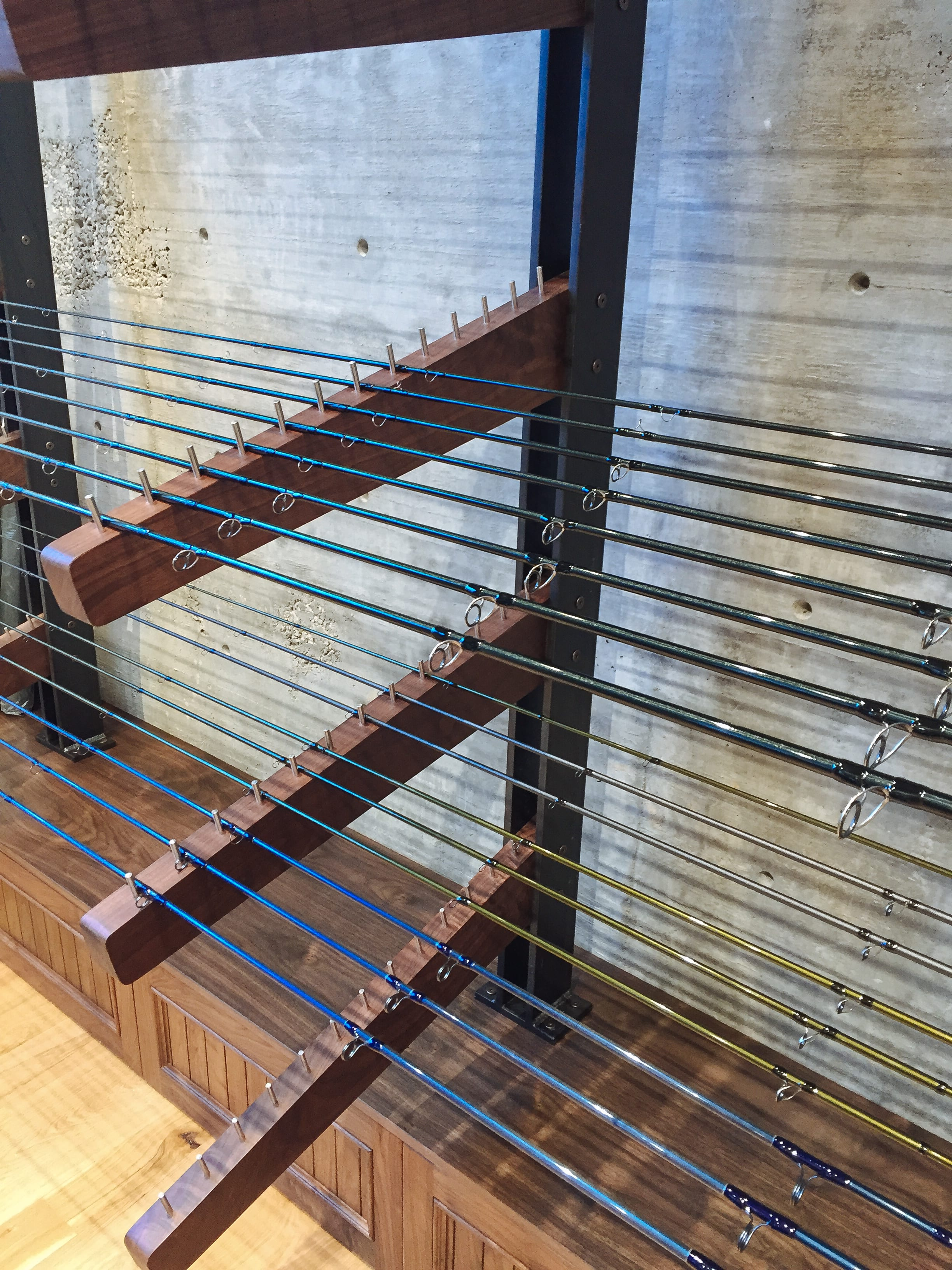 Caliber Sports walnut and steel fishing rod display