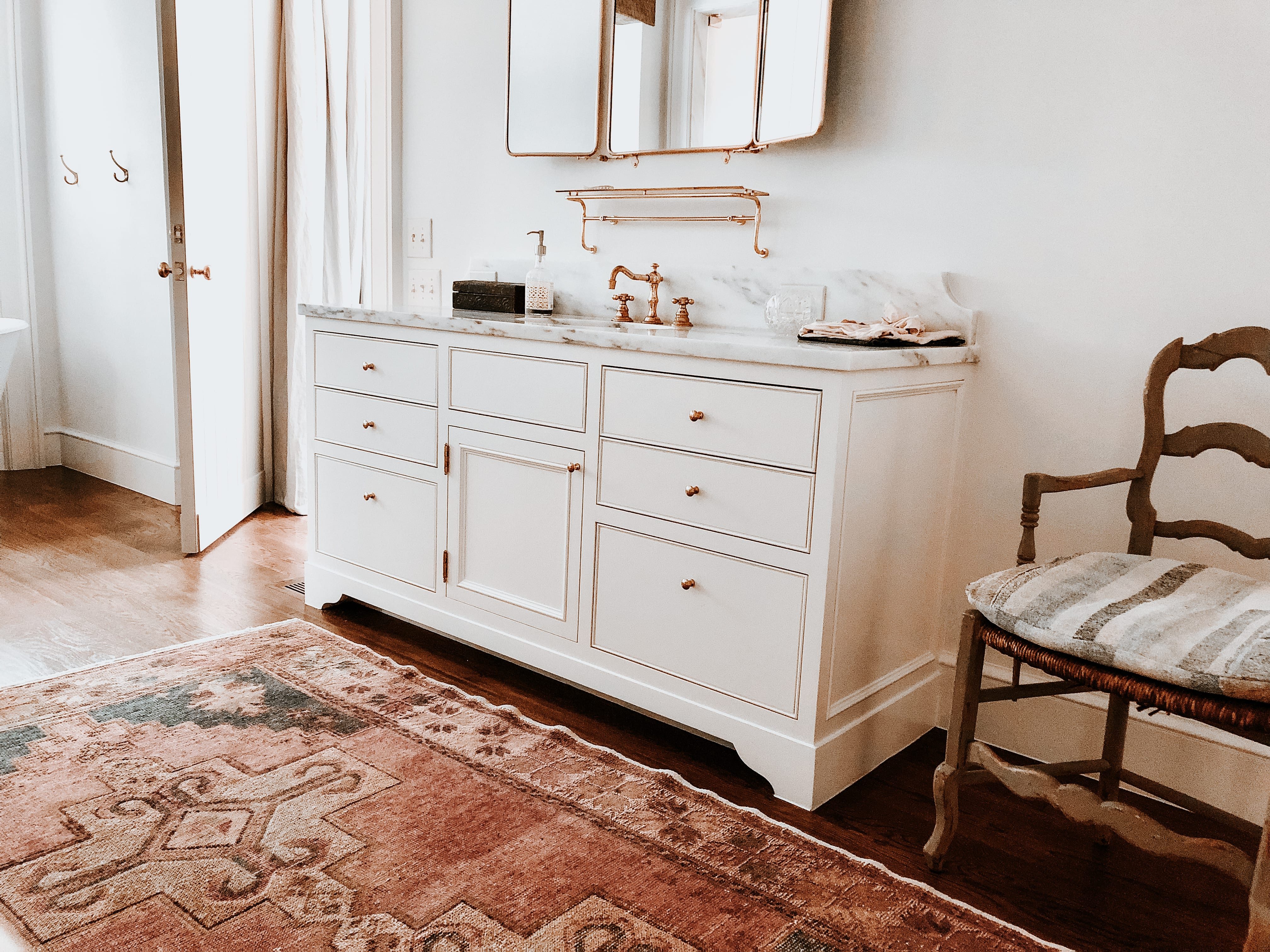 Timeless White Vanity with gold detailing and marble countertop
