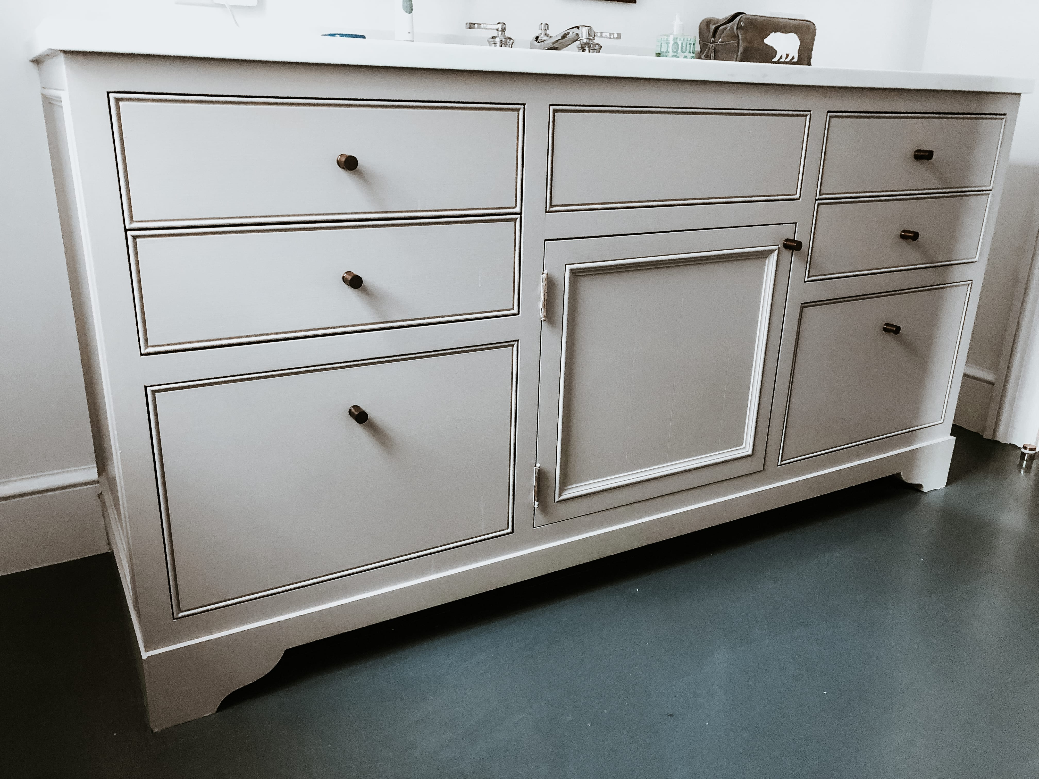 White Wooden Vanity with Walnut Detailing