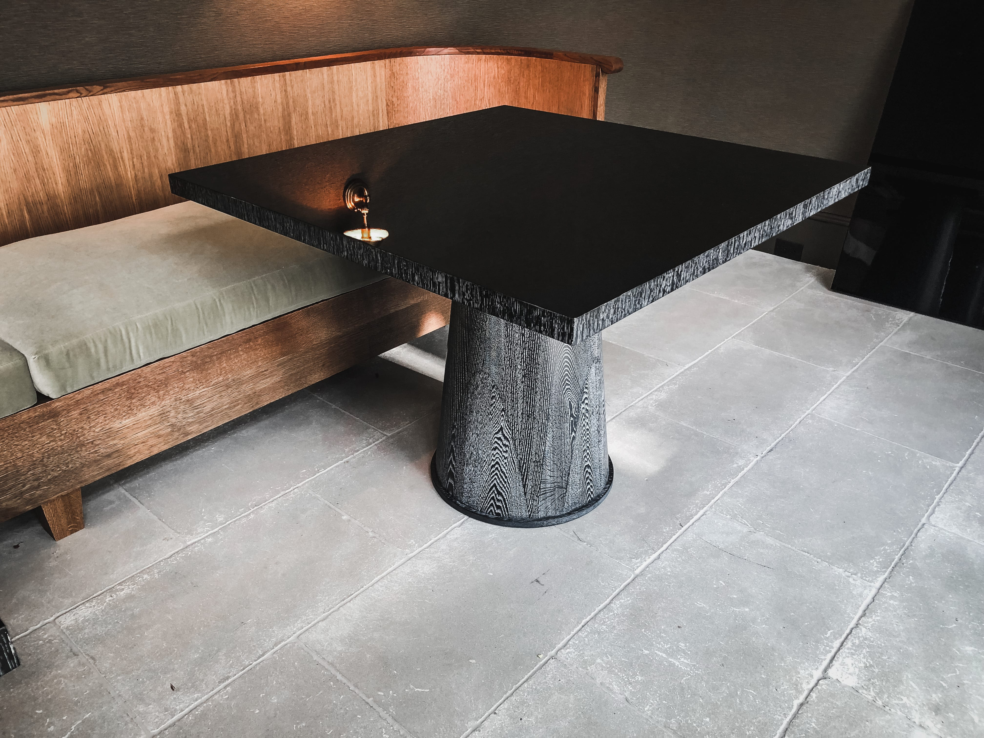 oak and gloss dining table side view
