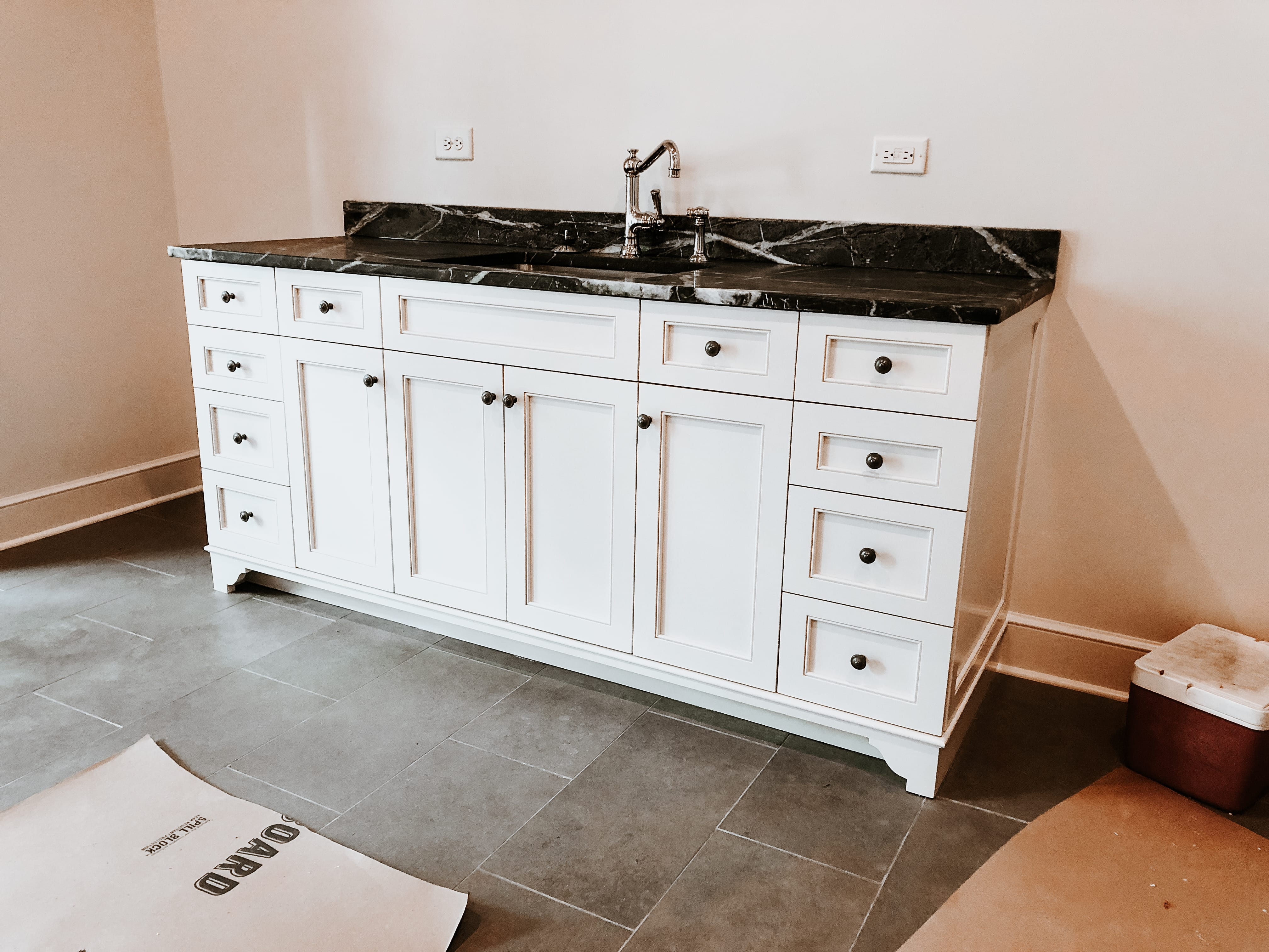 White Vanity with Black Marble Countertop