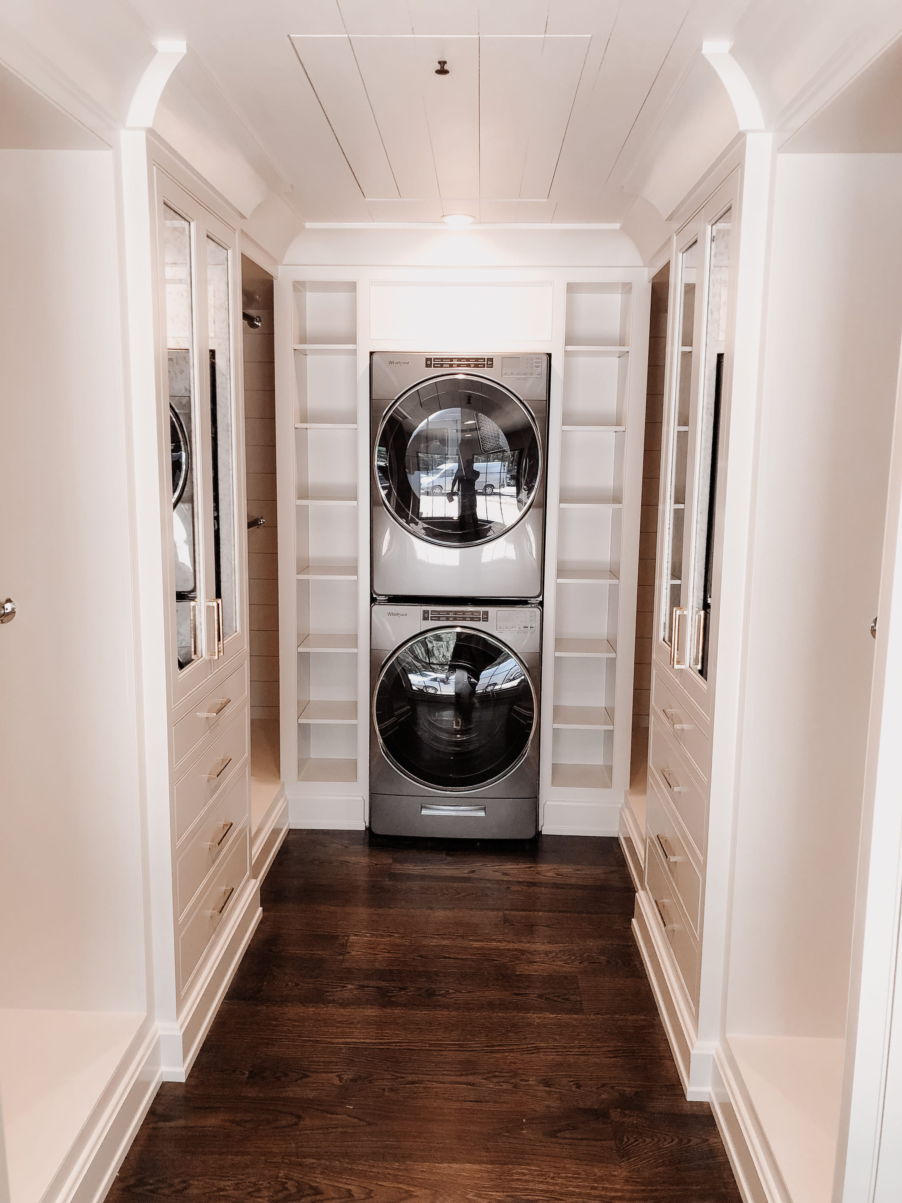 Built in Washer and Dryer Combo with White Shelving