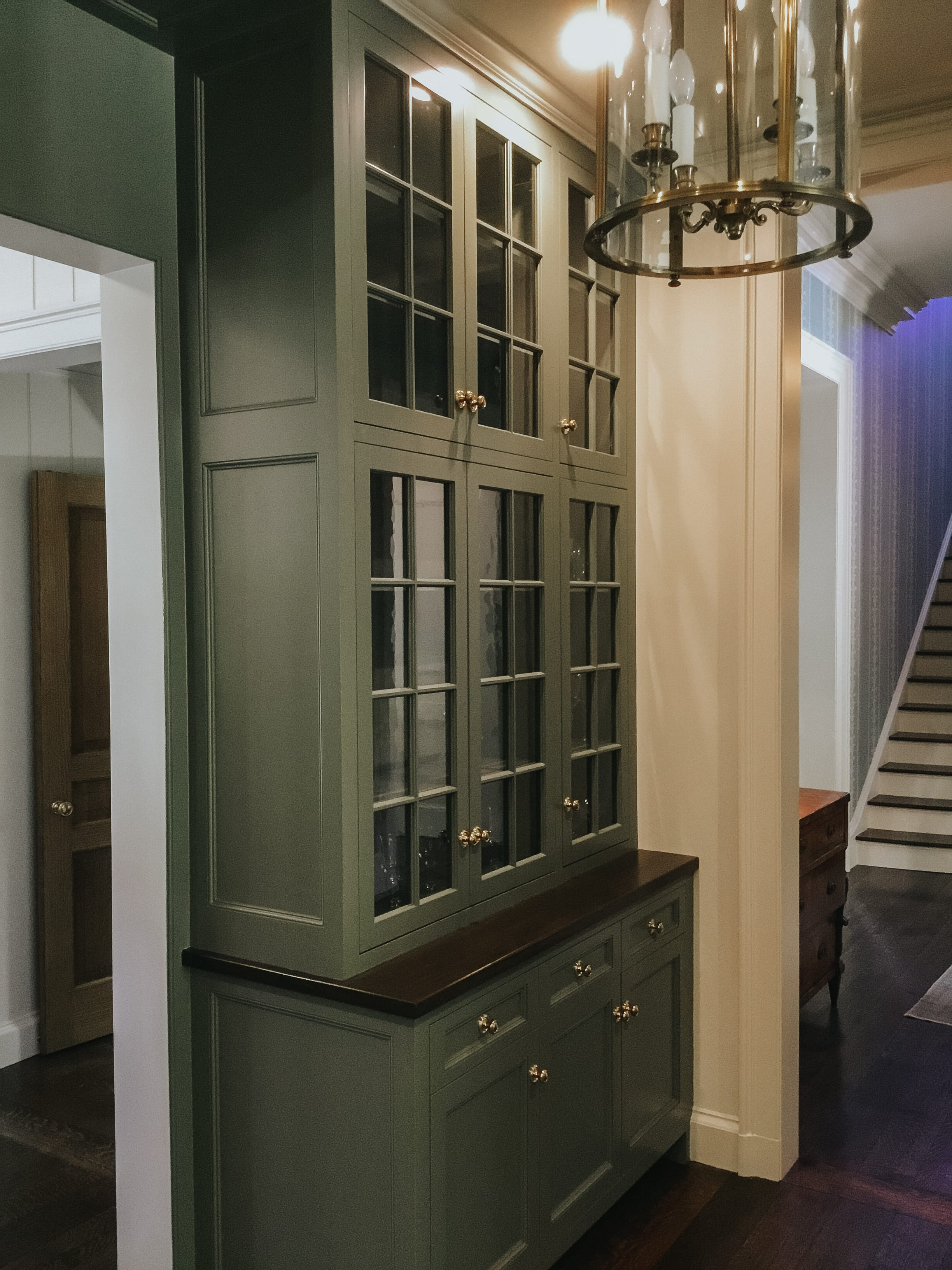 Dark Green Cabinets with Glass Windows side view