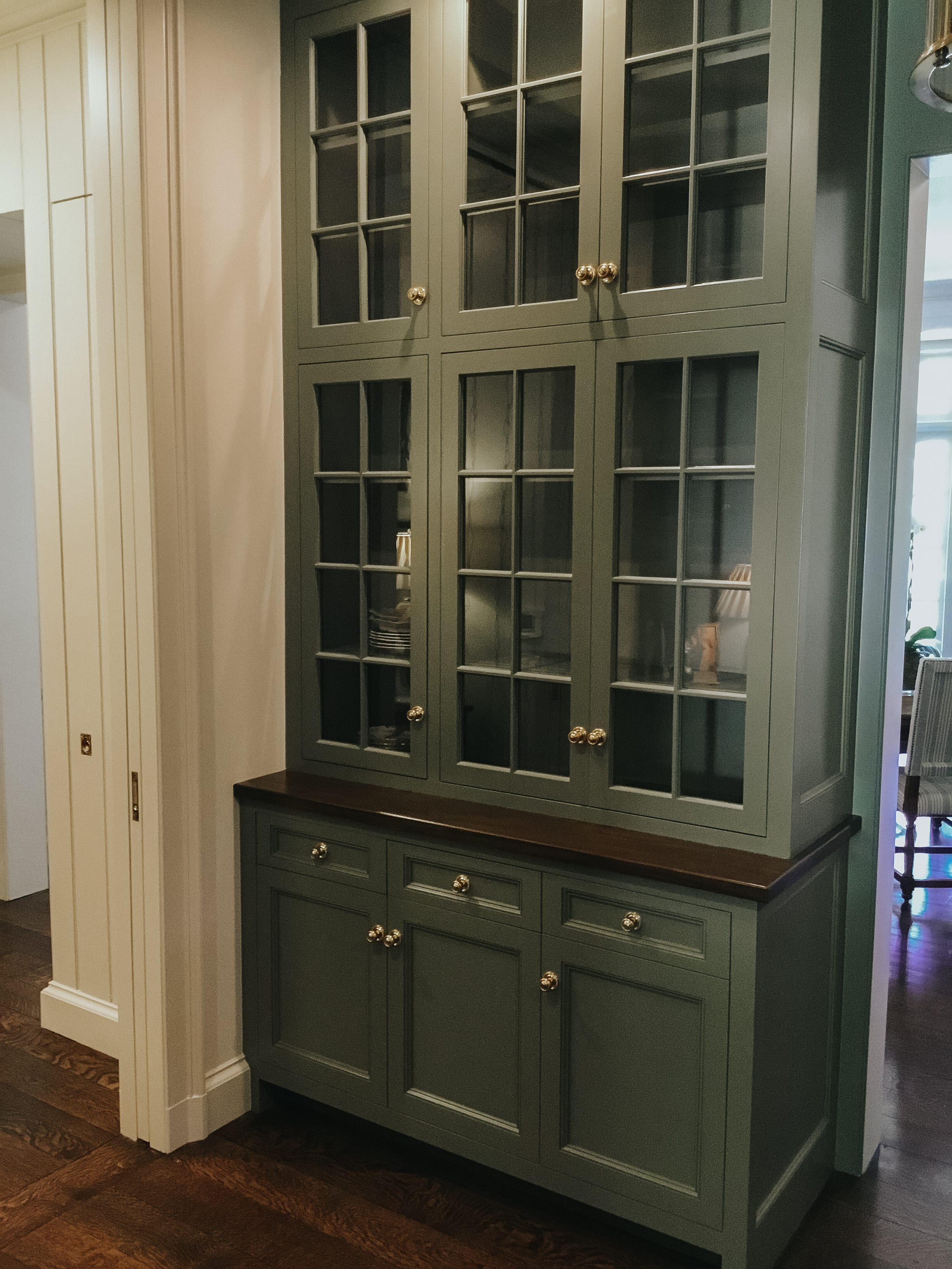 Dark Green Cabinets with Glass Windows