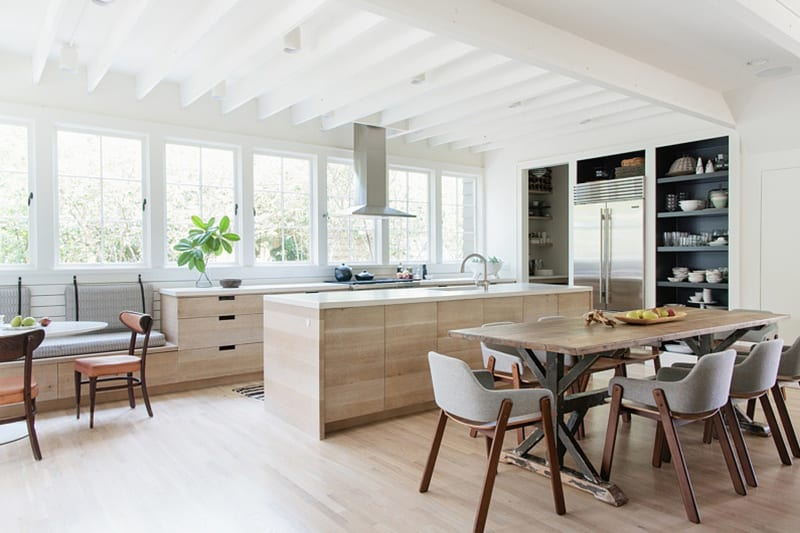 Airy White Open Kitchen with Wooden Cabinetry