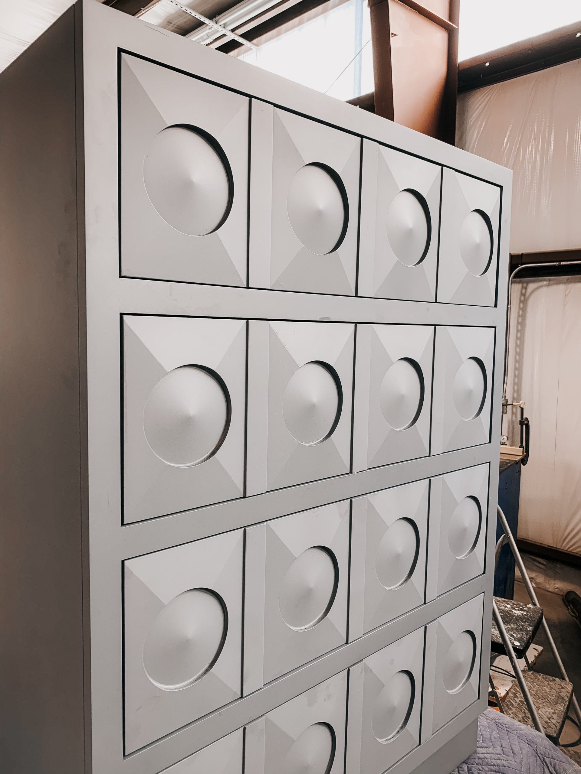 Cool Gray Dresser with Circular Details