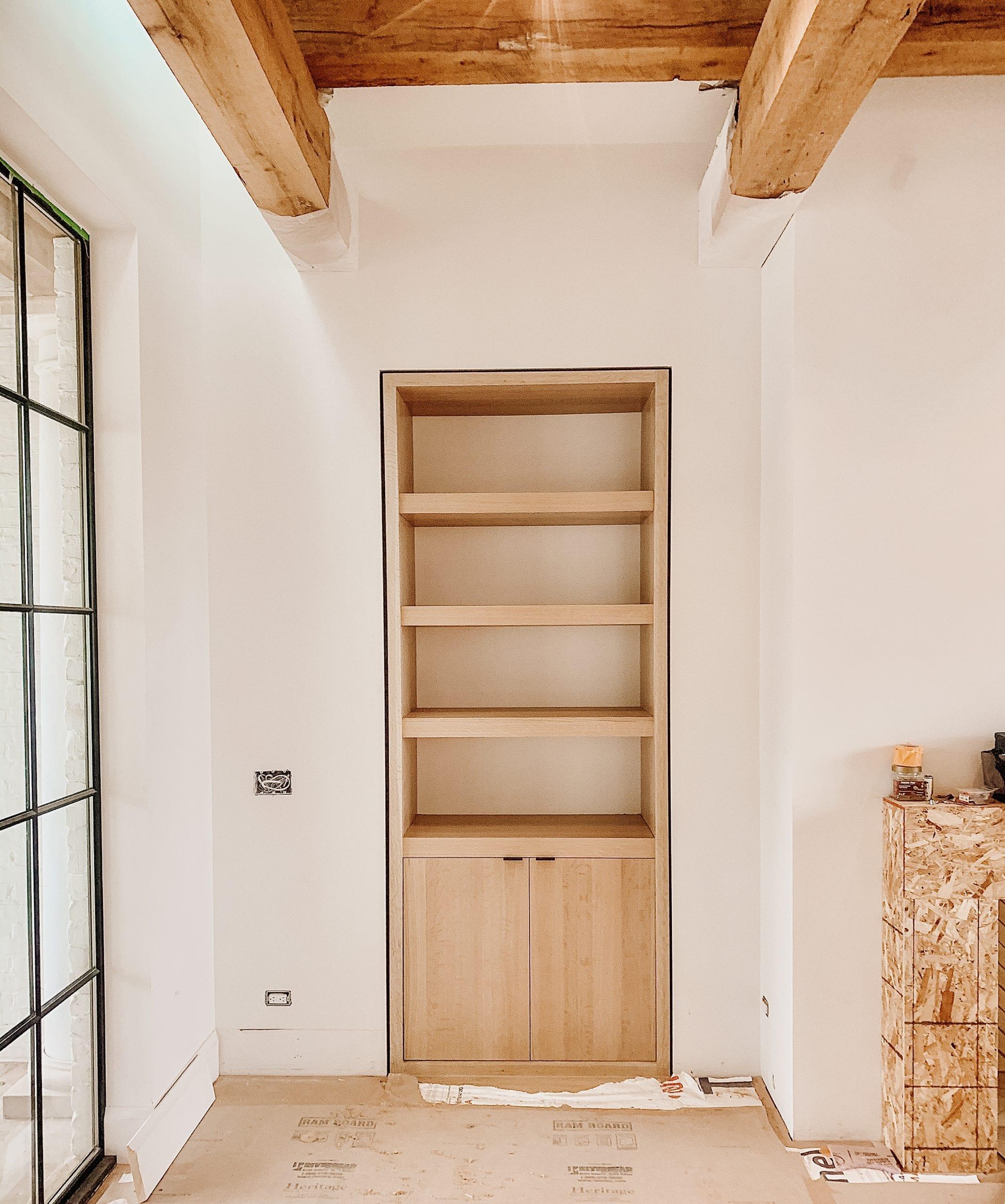 Built in wooden shelf with black details