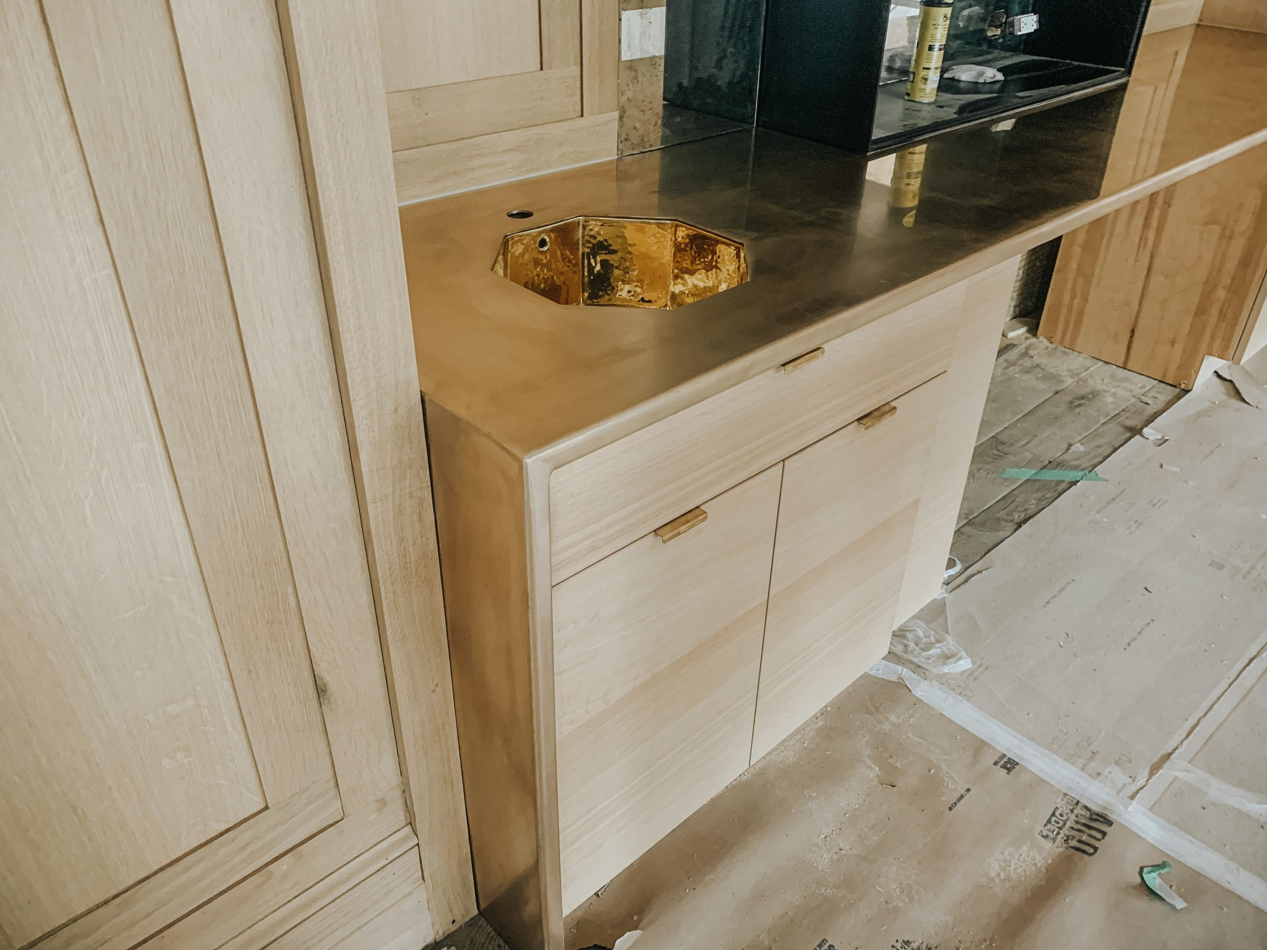 Oak Cabinets with Bronze Countertop