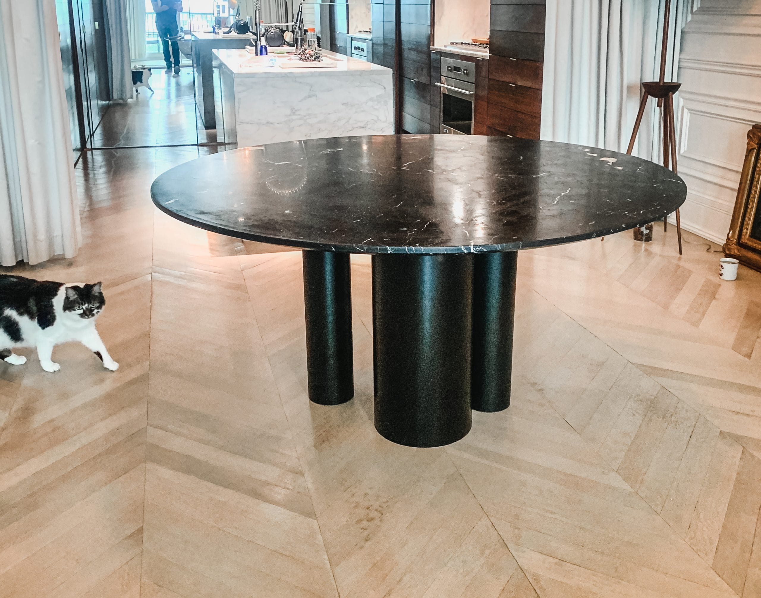 Marble and wood dining table from side