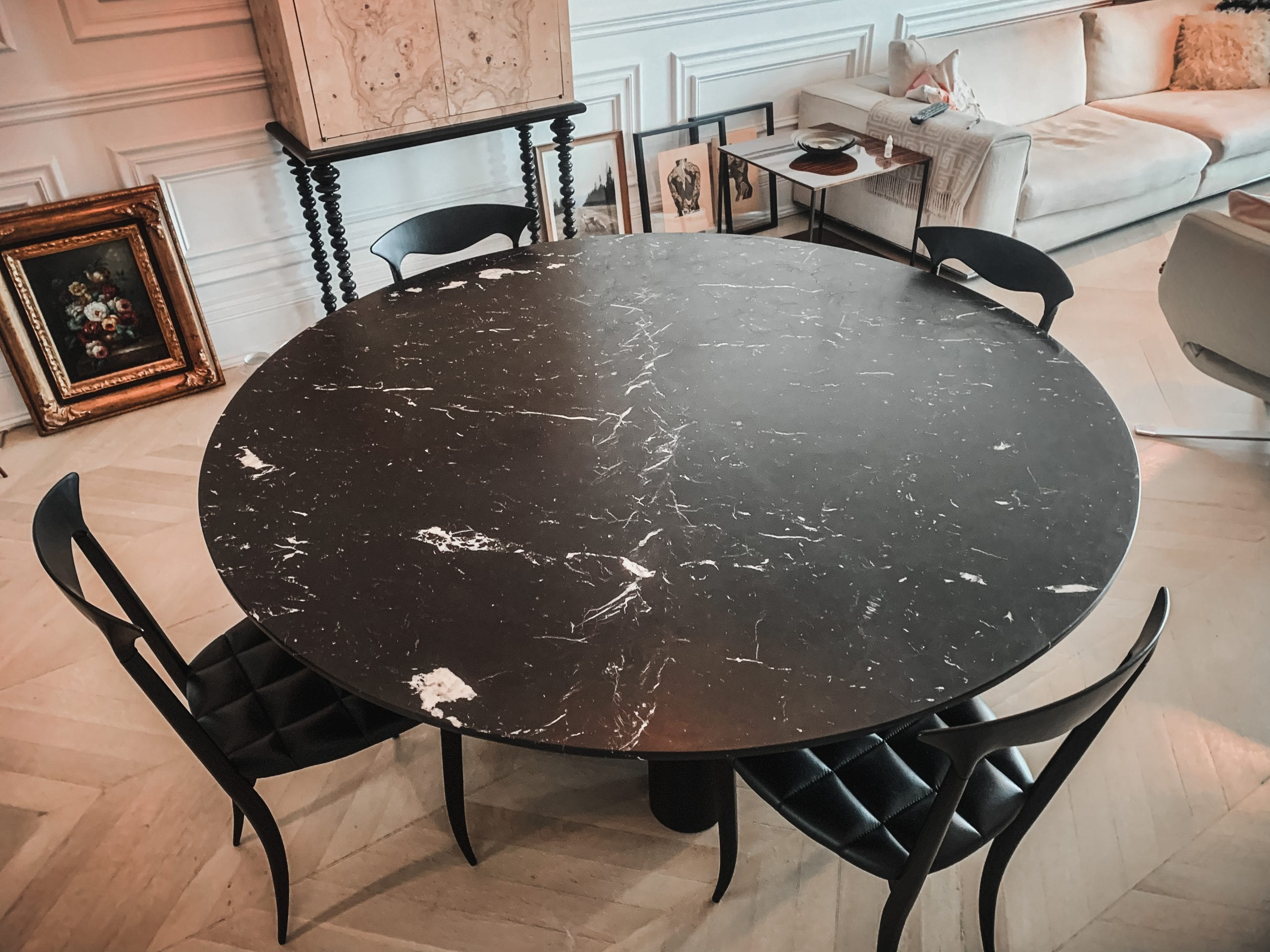 Marble and wood dining table with chairs from top