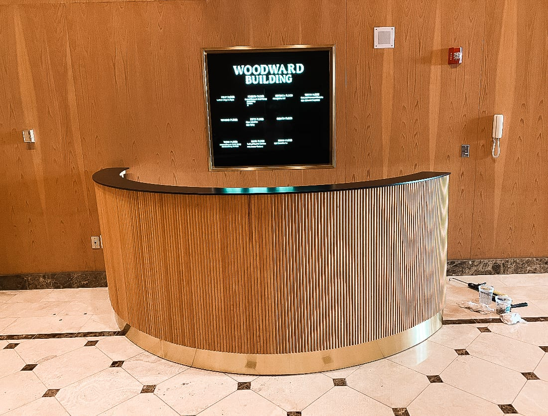Fluted Reception Desk with Glossy Black Top and Brass Base