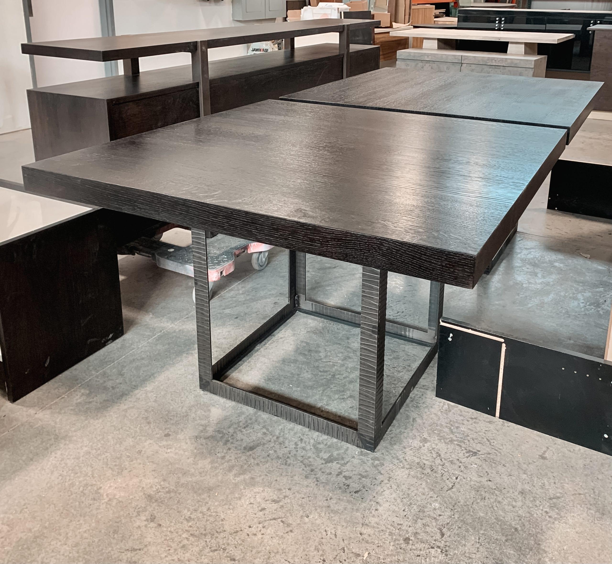 Textured, ebonized oak and iron tables