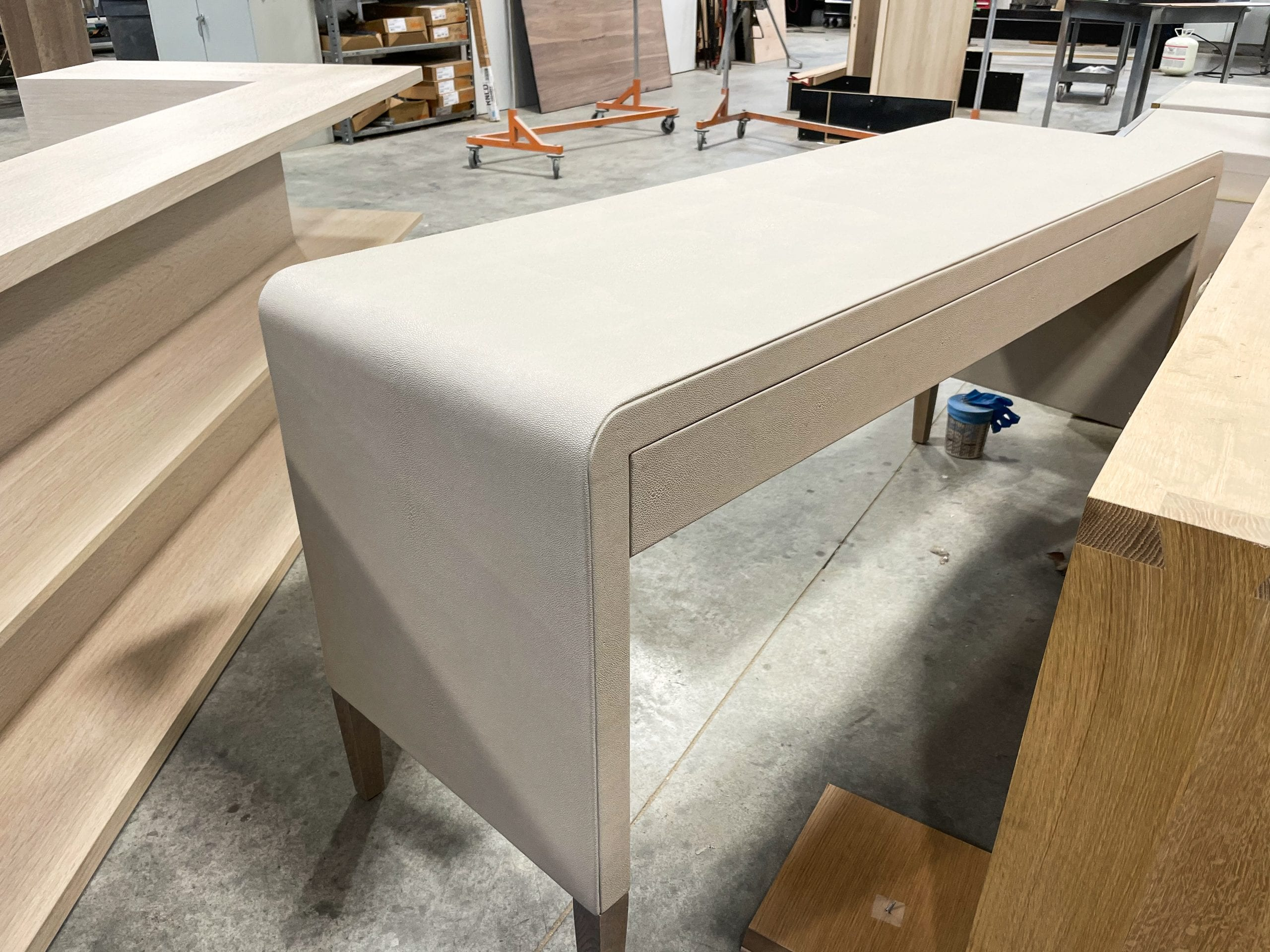 Back of White Leather Desk with Brass Pulls