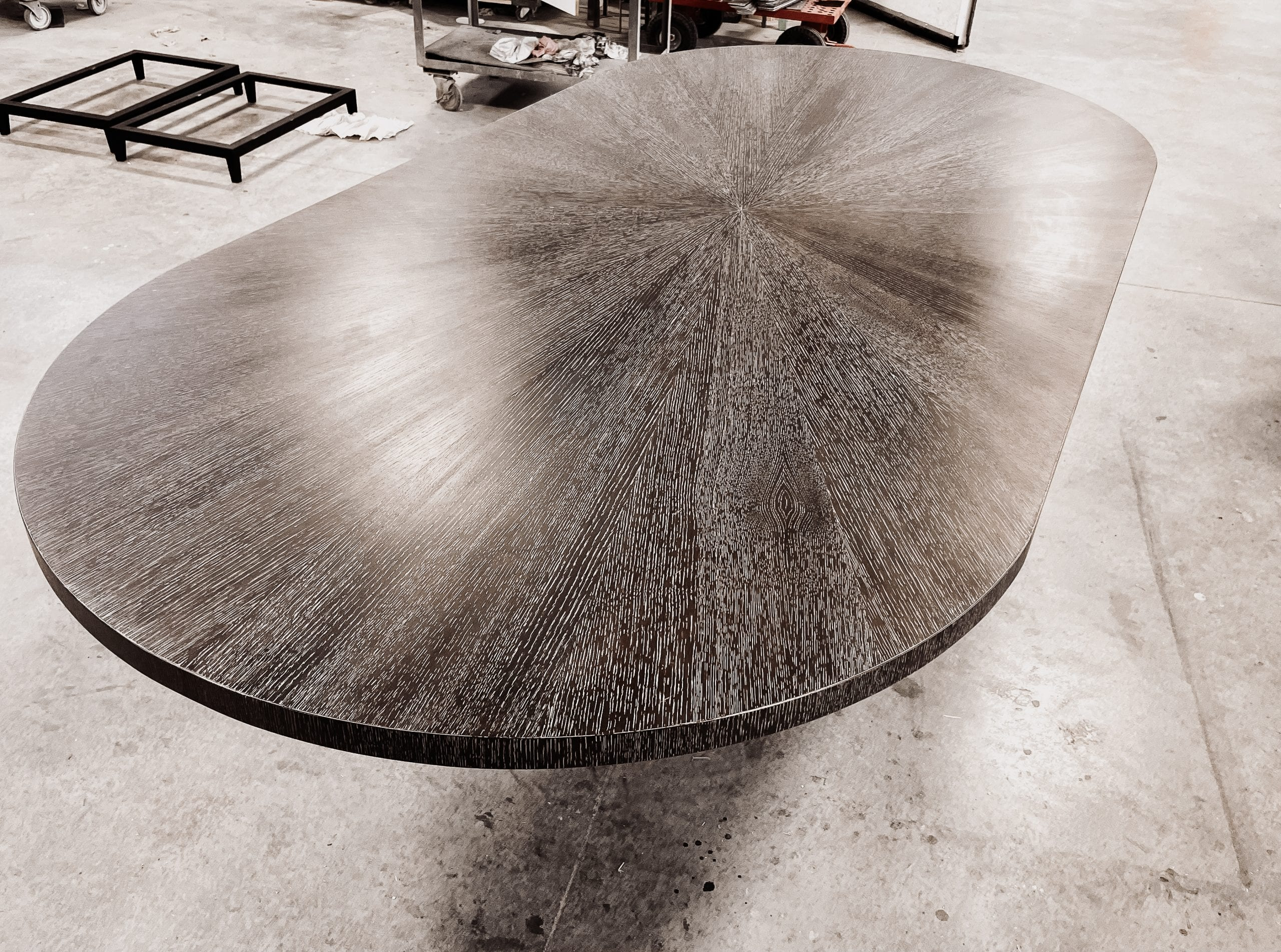 Radiate table in a beautiful gray finish